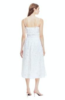 <ul><li>Embroidered cotton skirt</li><li>Full silhouette</li><li>Designed to be worn at the waist</li><li>Button closure at waistband</li><li>100% Cotton; Lined</li><li>Dry clean</li><li>Made in USA</li></ul>