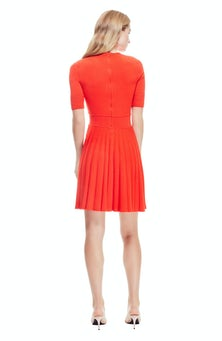 <ul><li>Full skirt knit dress</li><li>Fit and flare silhouette</li><li>Concealed zip fastening at center back</li><li>70% Viscose, 30% Polyester</li><li>Dry clean</li><li>Imported</li></ul>