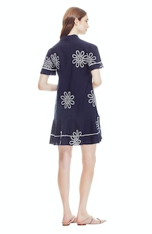 <ul><li>Floral eyelet flutter sleeve shirt dress</li><li>Straight, tunic fit with ruffle hem detail</li><li>Button fastenings at front</li><li>100% Cotton; Lined</li><li>Dry clean</li><li>Made in USA</li></ul>