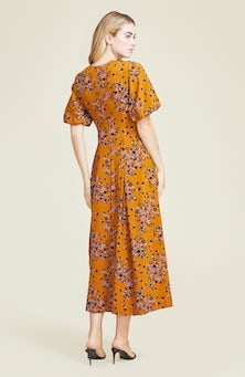 <ul><li>Floral printed crepe midi dress with blouson sleeves</li><li> Designed to be fitted at waist</li><li>Concealed zip fastening at center back</li><li> 92% Polyester, 8% Elastane</li><li>Machine wash cold</li><li>dry flat</li><li>Made in USA</li></ul>