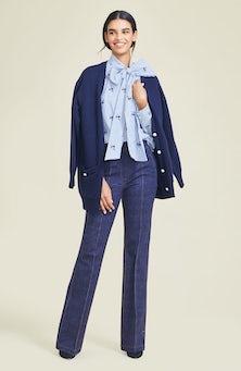 <ul><li>Embroidered stripe cotton top with blouson sleeves and bow detail</li><li>Designed for a slim fit</li><li>Pullover</li><li>100% Polyester</li><li>Machine wash cold</li><li>dry flat</li><li>Made in USA</li></ul>