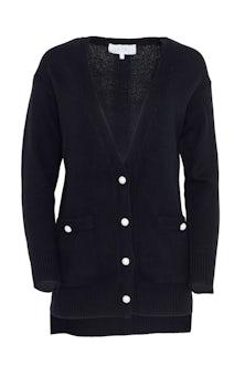 <ul><li>Long sleeve cardigan with pearl button detail</li><li>Designed for a loose fit</li><li>Button fastenings at front</li><li>Wool/Cashmere</li><li>Dry clean</li><li>Imported</li></ul>