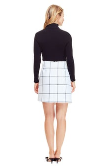 <ul><li>Windowpane skirt with asymmetric hem</li><li>Designed to be worn at the waist</li><li>Concealed zip fastening at center back</li><li>Polyester/Viscose</li><li>Lined</li><li>Dry clean</li><li>Made in USA </li></ul>