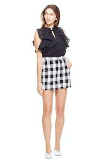 <ul><li>Gingham shorts with removable rope tie belt</li><li>76% Cotton 24% Polyester</li><li>Dry Clean Only</li></ul>