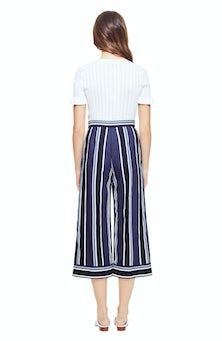 <ul><li>Short sleeve knit top with pointelle detail</li><li>63% Viscose 37% Nylon</li><li>Dry Clean Only</li></ul>