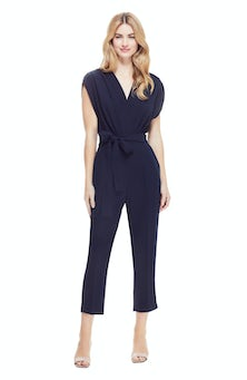 <ul><li>Fluid Crepe v-neck draped jumpsuit</li><li>Slim, straight fit with belt at waist</li><li>Concealed zip fastening at center back</li><li>100% Polyester</li><li>Machine wash cold, dry flat</li><li>Made in USA</li></ul>